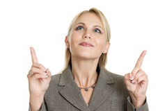 Business woman pointing up. Portrait of a business woman pointing up isolated on white Stock Images