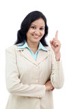 Business woman pointing up against white Stock Images