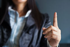 Business woman pointing up finger Stock Photo