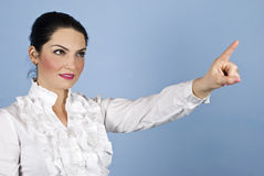 Business woman pointing up to copyspace Royalty Free Stock Photos