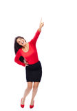 Business Woman pointing up. Woman Wearing red smiling pointing upwards isolated on White Royalty Free Stock Photos