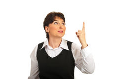 Business woman pointing upward Royalty Free Stock Image