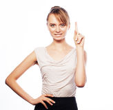 Business woman pointing at white background. Stock Image