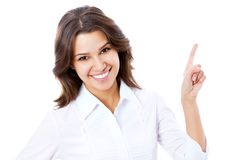 Business woman pointing at white background. Portrait of young business woman pointing at white background Stock Photo