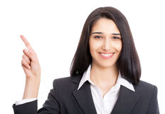 Business woman pointing at white background Royalty Free Stock Photo