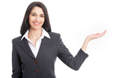 Business woman pointing at white background Royalty Free Stock Images