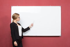 Business woman pointing at the whiteboard Stock Image