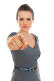 Business woman pointing on you. Focus on finger Stock Photos