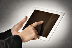 Business woman points tablet computer Royalty Free Stock Images