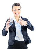 Business woman points to the phone. Stock Image