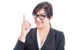 Business woman poiting finger up or having an idea Stock Photos