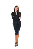 Business woman portrait. Brunette businesswoman standing, full body portrait, isolated on white royalty free stock photo