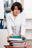 Business woman. Portrait of beautiful teacher in glasses with folders at her office royalty free stock image