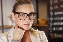 Business woman portrait. Closeup portrait of a serious business woman in the office, attractive young lady boss, good career and successful future royalty free stock photos