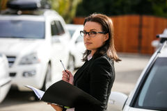 Business woman portrait. On a drive way Stock Photography