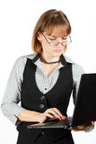 Business woman . Portrait of girl with glasses . Teacher . Portrait of girl with glasses . Business woman with a laptop Royalty Free Stock Photography