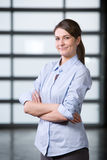 Business woman portrait in a modern office Stock Photos
