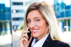 Business woman portrait outdoors talking at the phone Royalty Free Stock Photos