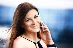 Business woman portrait outdoors talking Royalty Free Stock Photo