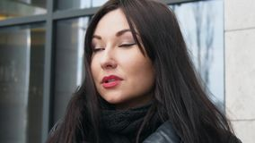 Business woman portrait. Serious mixed race female professional outdoor portrait closeup in the city stock footage