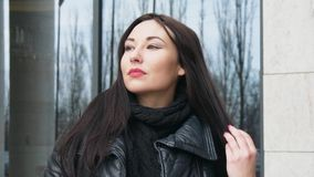 Business woman portrait. Serious mixed race female professional outdoor portrait closeup in the city stock video