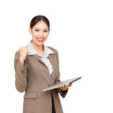 Business woman. Portrait of a successful young asian businesswoman with clenched fists celebrating success Stock Image