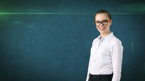 Business woman portrait in white skirt on isolated background looking stright with hair ban,orange and black glasses. Stock Photo