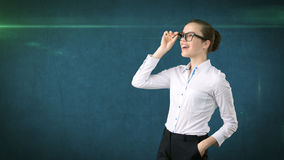 Business woman portrait in white skirt on isolated background. Model looking up with hair ban, orange and black glasses. Royalty Free Stock Photo