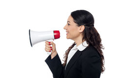 Business woman posing with megaphone Royalty Free Stock Photo