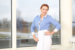 Business woman posing in office Stock Photography