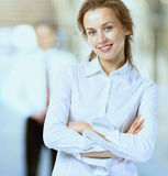 Business woman with a positive look and a cheerful smile, on a team work background. Business lady with positive look and cheerful smile posing for the camera Stock Photos