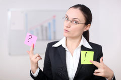 Business woman with postit. A business woman is holding post its in a conference room Stock Photography