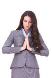 Business woman praying Stock Photo