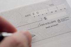 Business woman prepare writing a check. Close-up of business woman prepare writing a check Stock Images