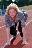 Business woman preparing to run a race Stock Photos