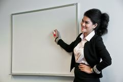 Business woman present with draw board on white background. And presenting Stock Image