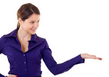 Business woman presenting. Something imaginary over white Stock Image