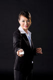 Business woman presenting a card Royalty Free Stock Photo