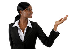 Business woman presenting into copyspace Stock Photography