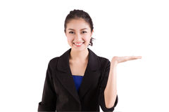 Business woman presenting a copyspace Royalty Free Stock Images