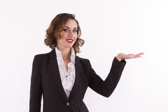 Business woman presenting a copyspace. Studio shot Royalty Free Stock Image