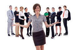 Business woman presenting her team. Isolated over a white backgroun Stock Images