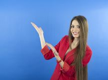 Business woman presenting. Isolated over blue background Royalty Free Stock Image