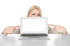 Business woman presenting laptop Stock Image