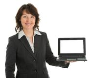 Business woman presenting laptopn stock photos