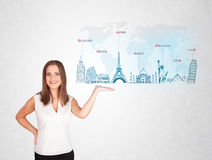Business woman presenting map with famous cities and landmarks Royalty Free Stock Photo