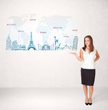 Business woman presenting map with famous cities and landmarks Royalty Free Stock Photos