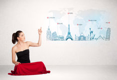 Business woman presenting map with famous cities and landmarks Stock Photo