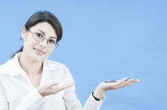 Business woman presenting an object Stock Image