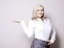 Business woman presenting a product Stock Image
